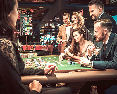 Six people playing at a roulette table in a casino